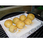 Seasoned yellow potatoes on BBQ